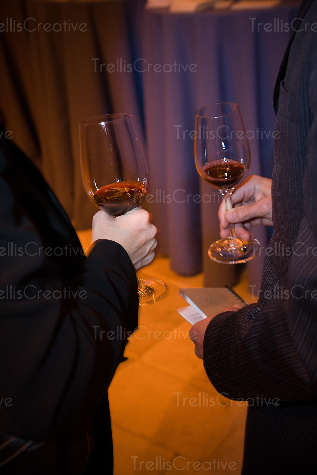 Two women holding glasses of red wine