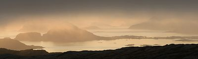 Sommarøy in midnight sun and fog, viewpoint from Senja, Norway