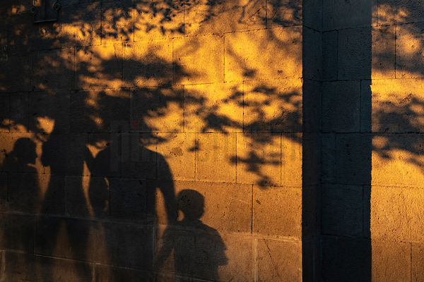 Shadow of a Family in the Streets of Yerevan at Sunset
