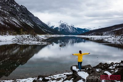 Woman near lake in autumn, Jasper National Park, Canada