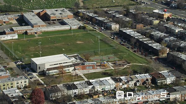 Past Webb Elementary School and Trinidad Recreation Center Playground in Washington DC  Mt. Olivet Cemetery in background. Sh...