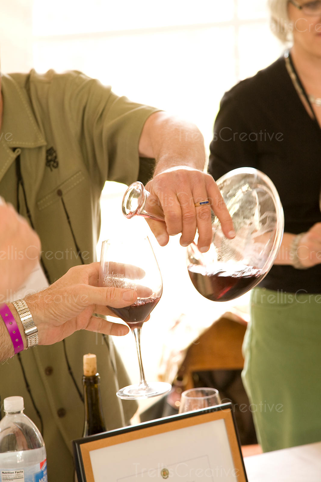 Pouring decanted red wine into a glass