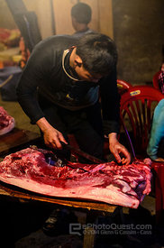 Cutting Meat from a Killed Pig