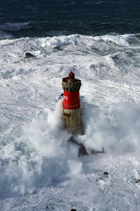 Stormy seas at the Pierres Noires lighthouse, Le Conquet, Armorique Regional Park. Finistere, Brittany, France, Iroise Sea. F...