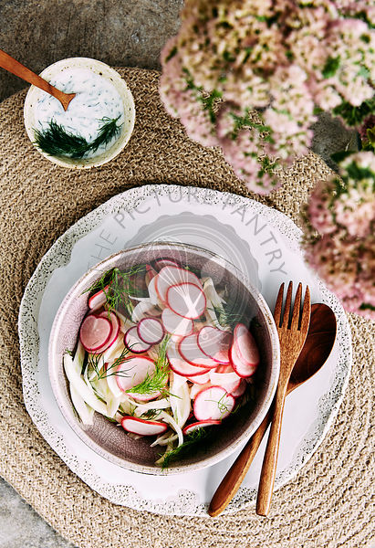 Clean eating fennel and pink raddish salad with a dill and yogurt dressing.