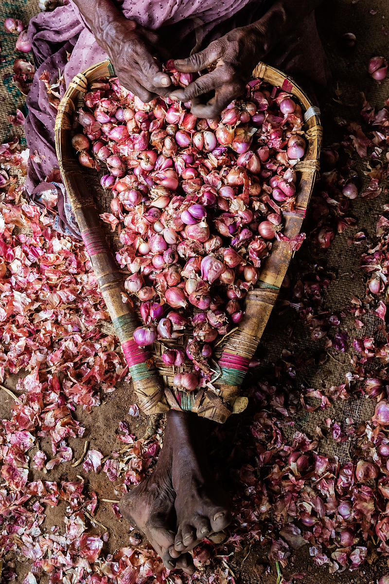 Woman Sorting Shallots at Vegetable Market
