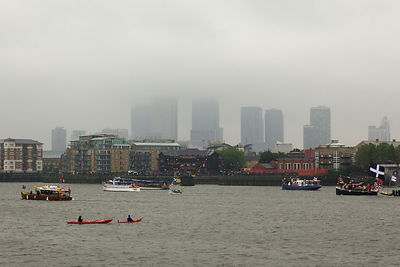 The Towers of Canary Wharf hidden by low cloud during the Thames River Pageant