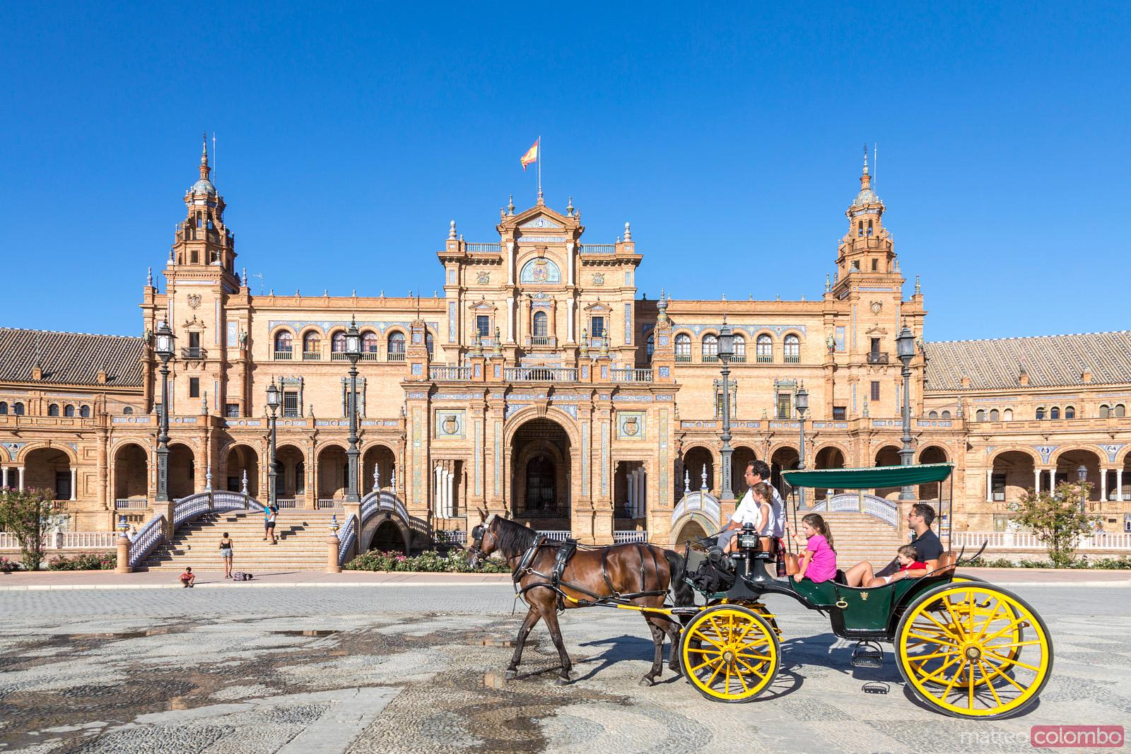 Horse cart with tourists in plaza de Espana, Sevilla, Spain