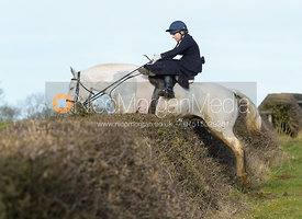 Chloe Edgar jumping a hedge at Leicester Lane