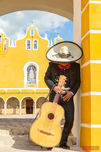 Musician with sombrero doing a siesta, Izamal, Yucatan, Mexico