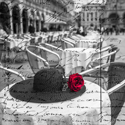 Old fashioned hat with a Red rose on cafe table, Venice, Italy