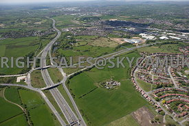 Rochdale high level wide angle aerial photograph looking across the M62 junction 20 motorway and open farmland either side of...