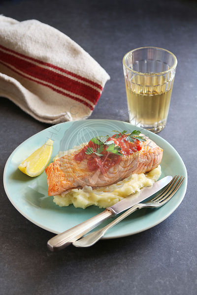 Fried salmon steak with mashed potatoes and garlic tomato sauce