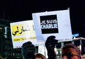 Amsterdam, Netherlands 2015-01-08:  'Je suis Charlie' signs, also in Arabic, held by participants.