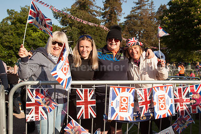 Royal fans from Plymouth enthusiastically waving their flags as the wait in The Long Walk Windsor for the royal couple