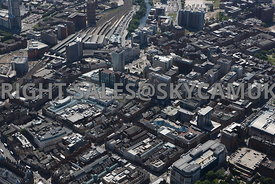 Leeds high level aerial photograph looking across The Headrow towards main railway station New Station Street