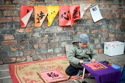 A calligrapher on the streets of Hanoi,