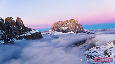 Aerial view of mountain peak with low clouds, Dolomites
