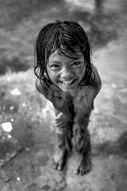 _W_P7683-Cambodian-little-girl-laughing-after-the-rain