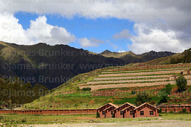 Modern adobe buildings and terraces of Inca site, Chinchero, near Cusco, Peru