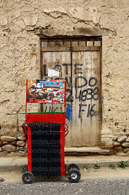 Mobile pizza cart and for sale notice on old wooden door, Tarija, Bolivia