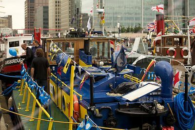 Boats Preparing for the River Pageant with Canary Wharf in the Background