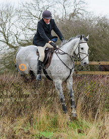 Alex Brooman-White jumping a hedge near Mrs Wilson's covert