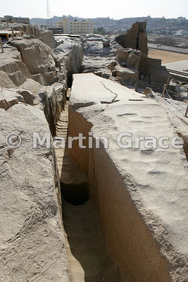 A part-hewn granite structure, left unfinished at the Northern Quarries, Aswan, Egypt