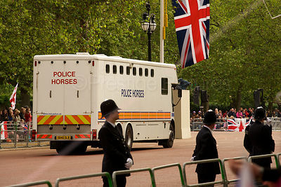 Police Horsebox Driving Down The Mall Under Large Union Jack
