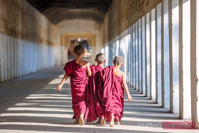 Novice monks walking at temple, Bagan, Myanmar