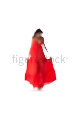 A blurred woman walking in a red dress – shot from mid level.