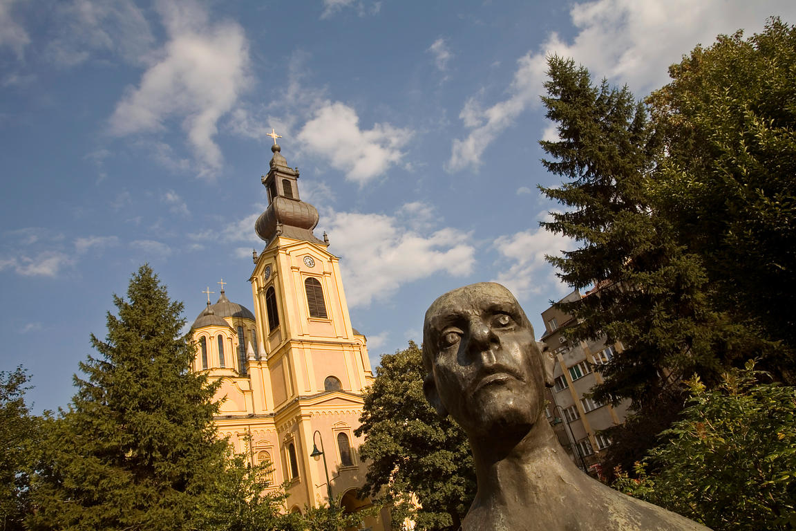 Bosnia - Sarajevo - The Orthodox Cathedral and a statue of Mesa Selimovic