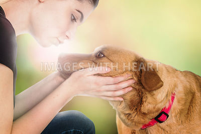 Beautiful Young Woman Loving on Dog Outdoors
