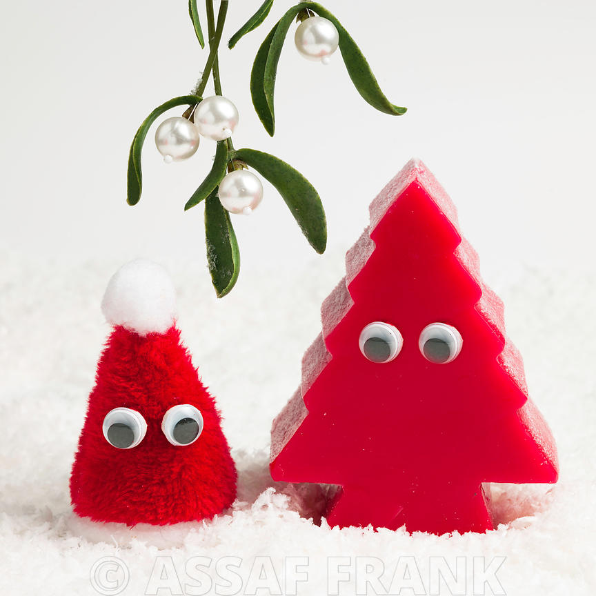 Santa hat and red chritmas tree with eyes