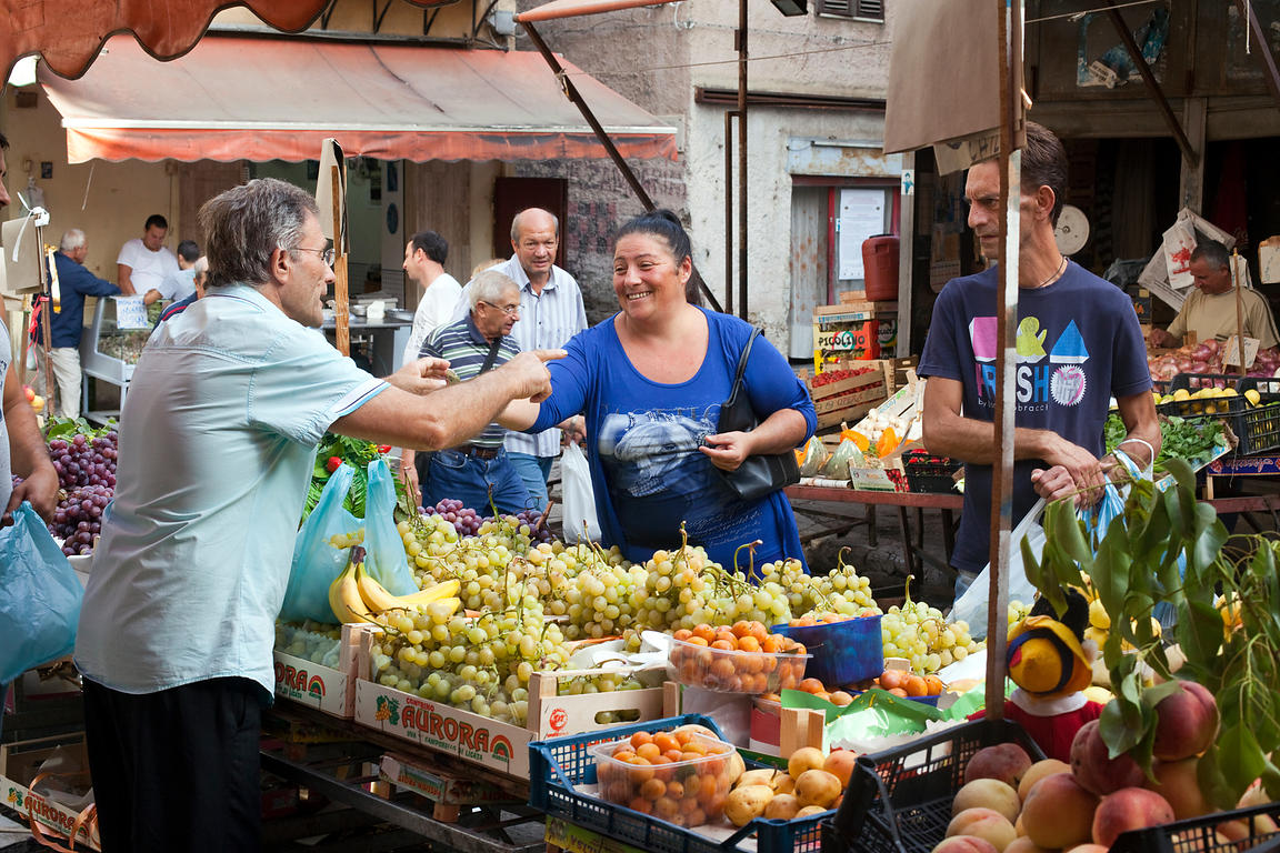 Italy - Palermo - A customer buys grapes from the Capo Market