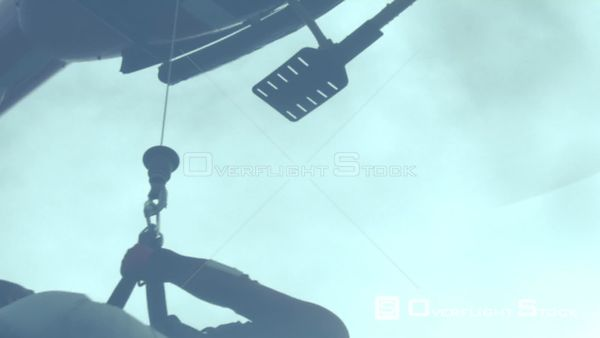 Aerial of two men hanging below a rescue helicopter Cape Town Western Cape South Africa