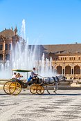 Horse carriage with tourists in plaza de Espana, Seville, Spain