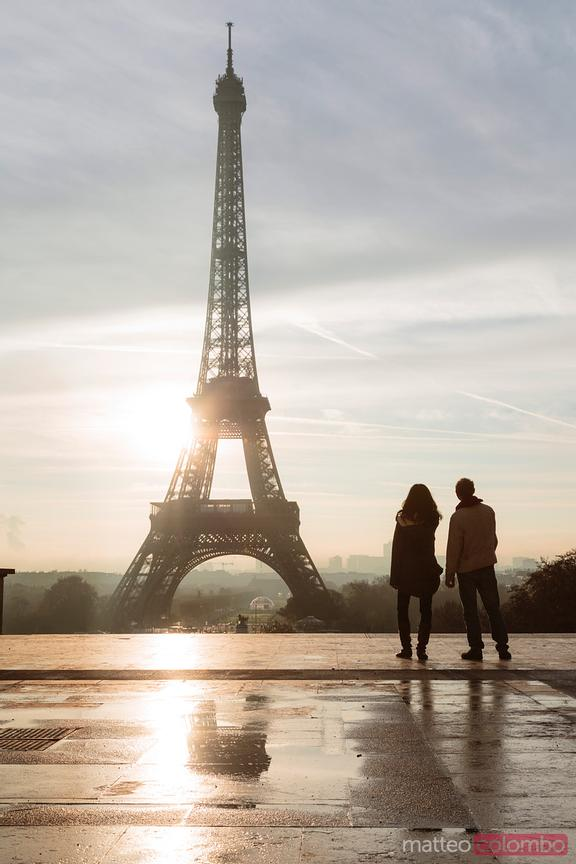 Tourists in front of the Eiffel tower, Paris, France