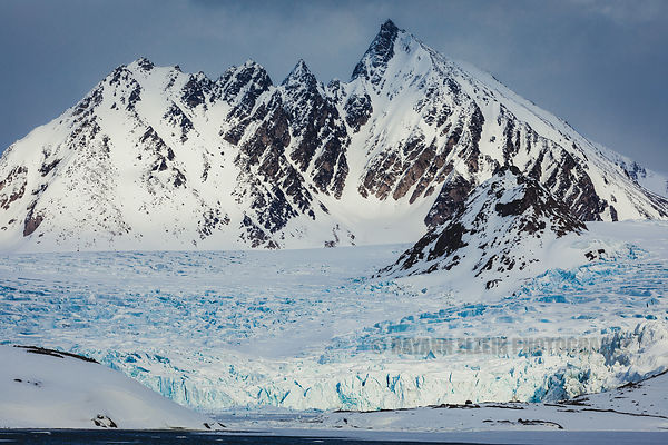 Typical view of mountain peaks and glacier in Svalbard