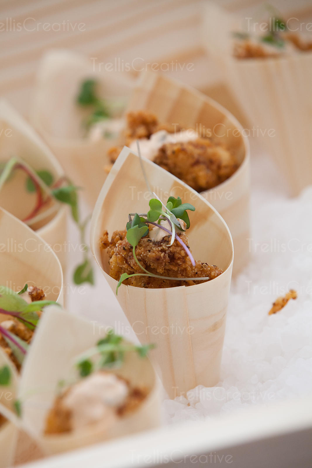 Small bite sized pieces of fried chicken served in a cone