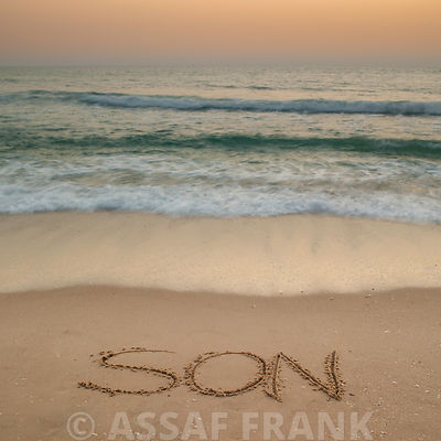 Sand writing - Word Son written on beach