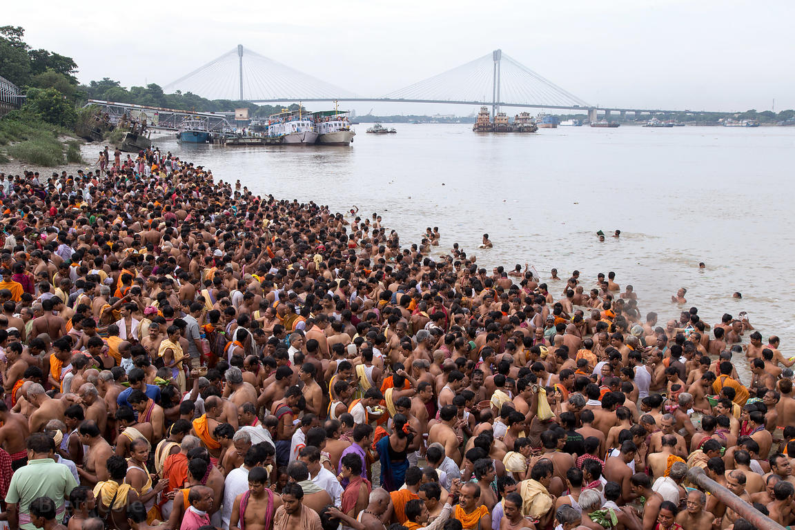 Hindus pray for deceased relatives along the Hooghly River (aka Ganges) during Mahalaya, Babughat, Kolkata, India