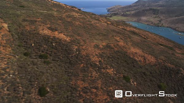 Flying Around a Rugged Hillside to a View of a Harbor on Santa Catalina.