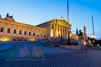 Austria, Vienna, driveway to lighted parliament building at twilight