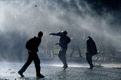 Czech Republic - Prague - Demostrator throws missile at police lines