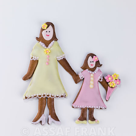 Gingerbread mother and child on white background