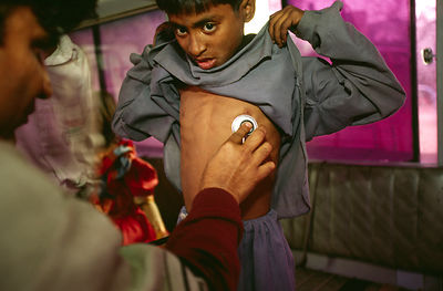India - Delhi - A child is checked for TB