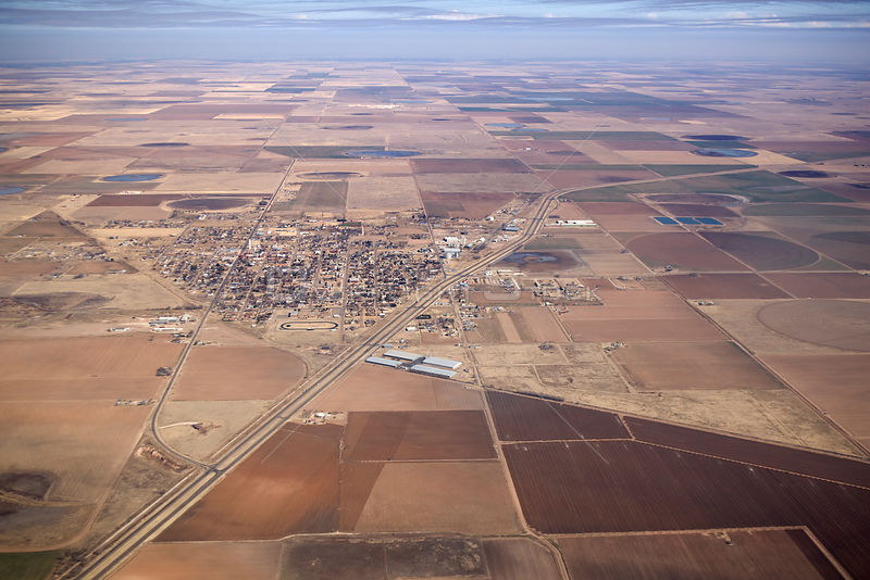 Aerial view of the town of Lockney surrounded by fields of monoculture agriculture, Floyd County, high plains of Texas, USA