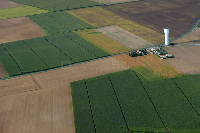 Aerial view of corn fields and farm buildings, South Vendee, France, July 2017.
