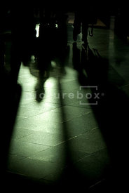 An atmospheric image of shadows at an airport.